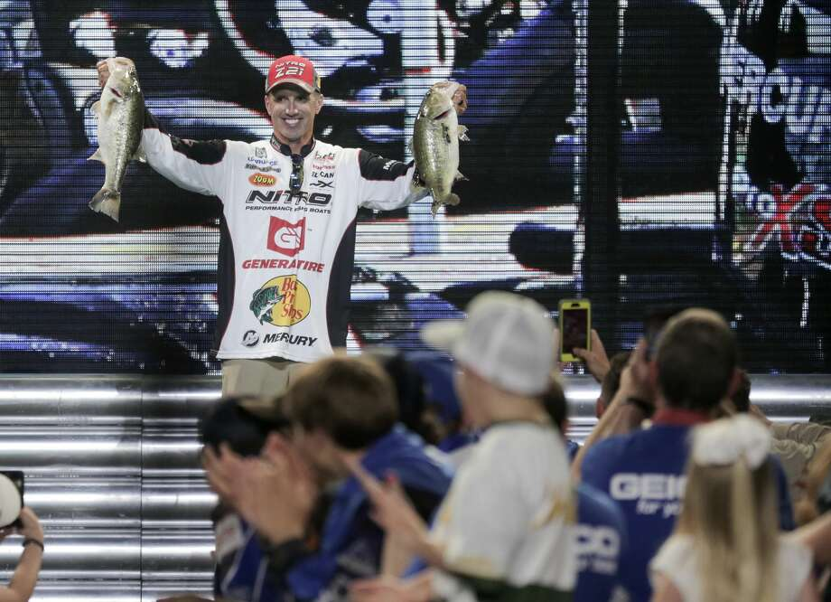 Edwin Evers holds up two bass he caught to place him in third after the day two weigh in for the Bassmaster Classicon Saturday, March 25, 2017, in Houston. ( Elizabeth Conley / Houston Chronicle ) Photo: Elizabeth Conley/Houston Chronicle