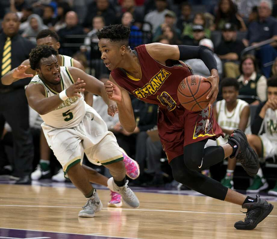 Esperanza�s Kezie Okpala (0) drives around Moreau Catholic�s Jullen Ison (5) during the fourth quarter of their CIF Boys Division II high school state championship basketball game, Saturday, March 25, 2017 in Sacramento, Calif. Esperanza won 72-65. Photo: D. Ross Cameron, Special To The Chronicle