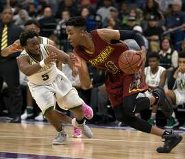 Esperanza�s Kezie Okpala (0) drives around Moreau Catholic�s Jullen Ison (5) during the fourth quarter of their CIF Boys Division II high school state championship basketball game, Saturday, March 25, 2017 in Sacramento, Calif. Esperanza won 72-65.