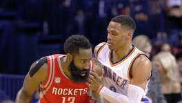 The picture tells it all as two candidates for the league MVP - Rockets guard James Harden, left, and Thunder guard Russell Westbrook - go one-on-one.