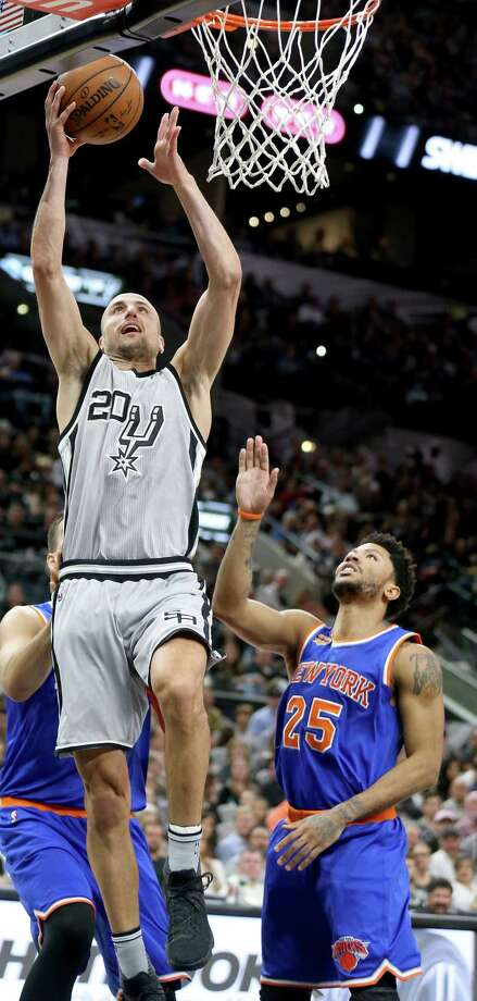San Antonio Spurs' Manu Ginobili shoots around New York Knicks' Derrick Rose during first half action Saturday March 25, 2017 at the AT&T Center. Photo: Edward A. Ornelas, San Antonio Express-News / © 2017 San Antonio Express-News