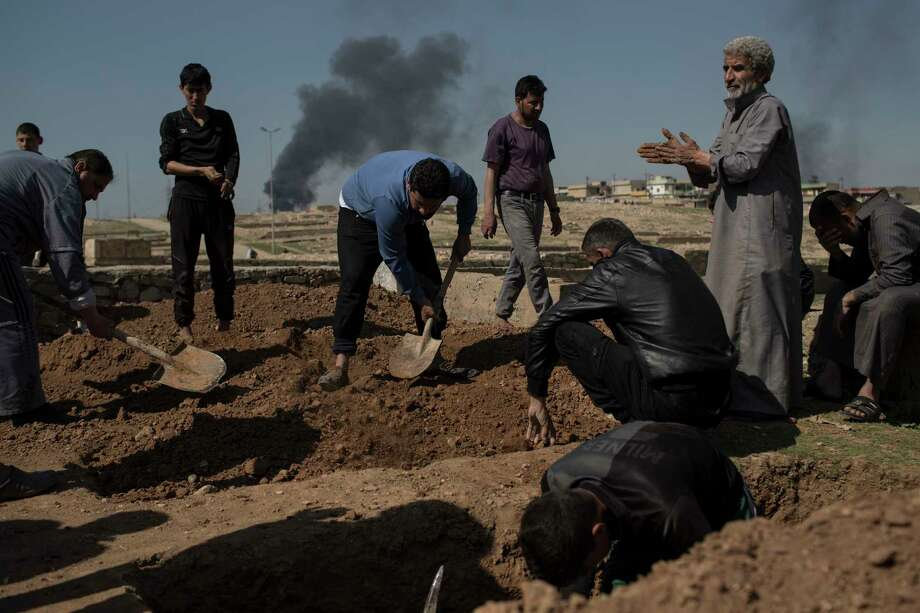 Relatives and friends bury the body of Khadeer, who was killed during fighting between Iraqi security forces and Islamic State militants, on the western side of Mosul, Iraq, Saturday, March 25, 2017. (AP Photo/Felipe Dana) Photo: Felipe Dana, STF / Copyright 2017 The Associated Press. All rights reserved.