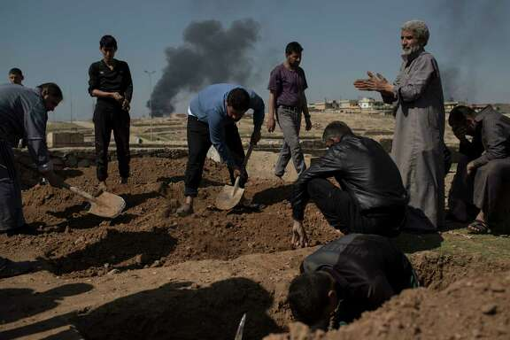 Relatives and friends bury the body of Khadeer, who was killed during fighting between Iraqi security forces and Islamic State militants, on the western side of Mosul, Iraq, Saturday, March 25, 2017. (AP Photo/Felipe Dana)