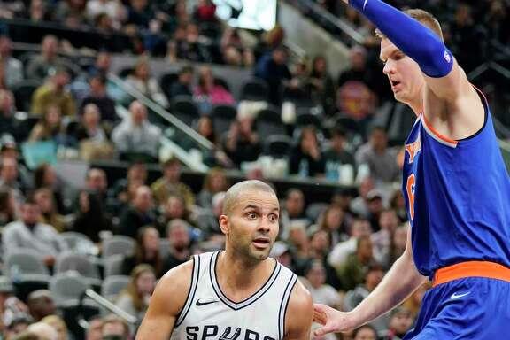 New York Knicks guard Derrick Rose (25) attempts to evade San Antonio Spurs forward Kawhi Leonard during the first half of an NBA basketball game, Saturday, March 25, 2017, in San Antonio. (AP Photo/Darren Abate)