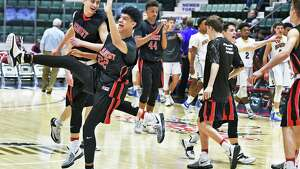 Albany Academy players celebrate their Class A Federation semi win over Irondequoit at the Civic Center Saturday March 25, 2017 in Glens Falls, NY.  (John Carl D'Annibale / Times Union)