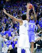 Kentucky freshman Malik Monk, right, scored 47 points and hit the game-winning 3-pointer in the Wildcats' 103-100 victory over North Carolina in Las Vegas on Dec. 17 when the South Regional finalists last played each other.