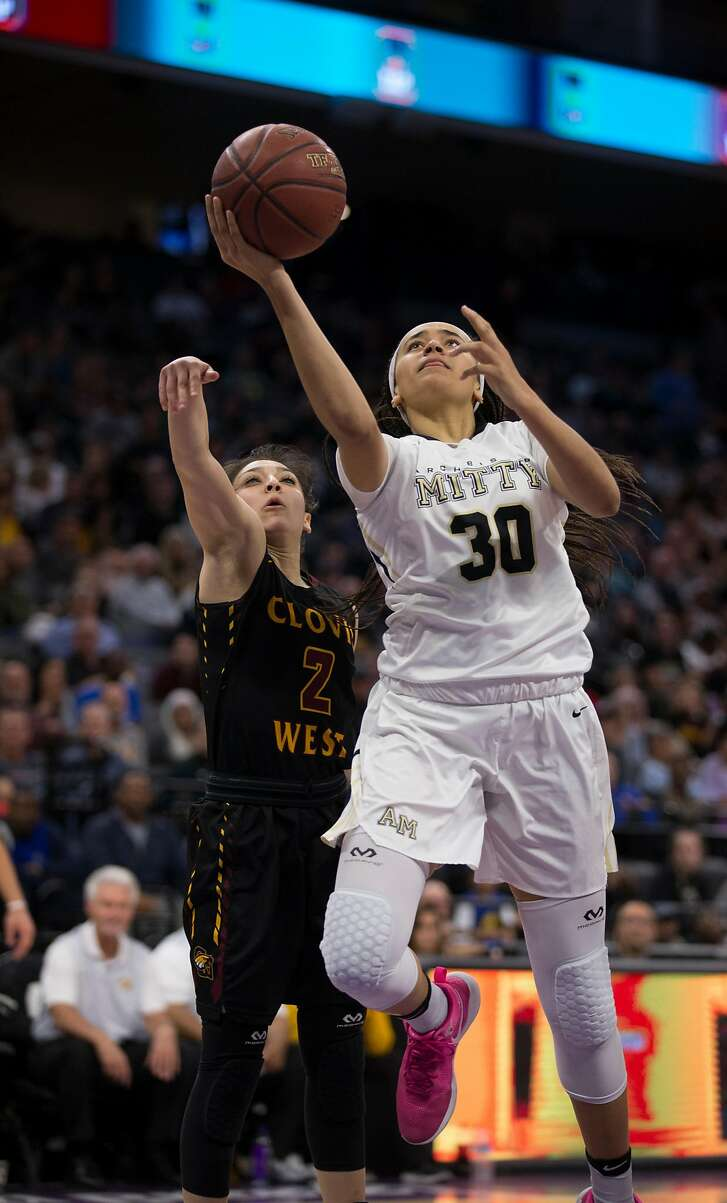 Archbishop Mitty's Haley Jones (30) takes the ball the basket ahead of Clovis West's Danae Marquez (2) during the second quarter of their CIF Girls Open Division high school state championship basketball game, Saturday, March 25, 2017 in Sacramento, Calif.