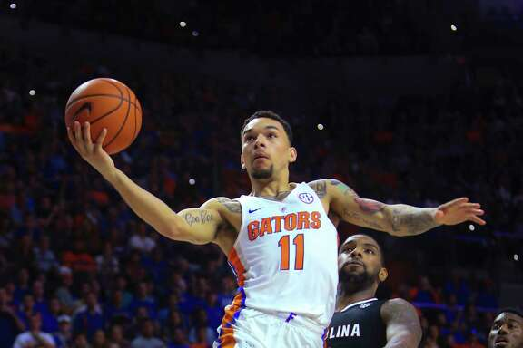 Sunday's East Regional title game will be the third time this season that Florida's Chris Chiozza, left, and South Carolina's Sindarius Thornwell have faced each other. The teams split their first two games, with the home team winning both.
