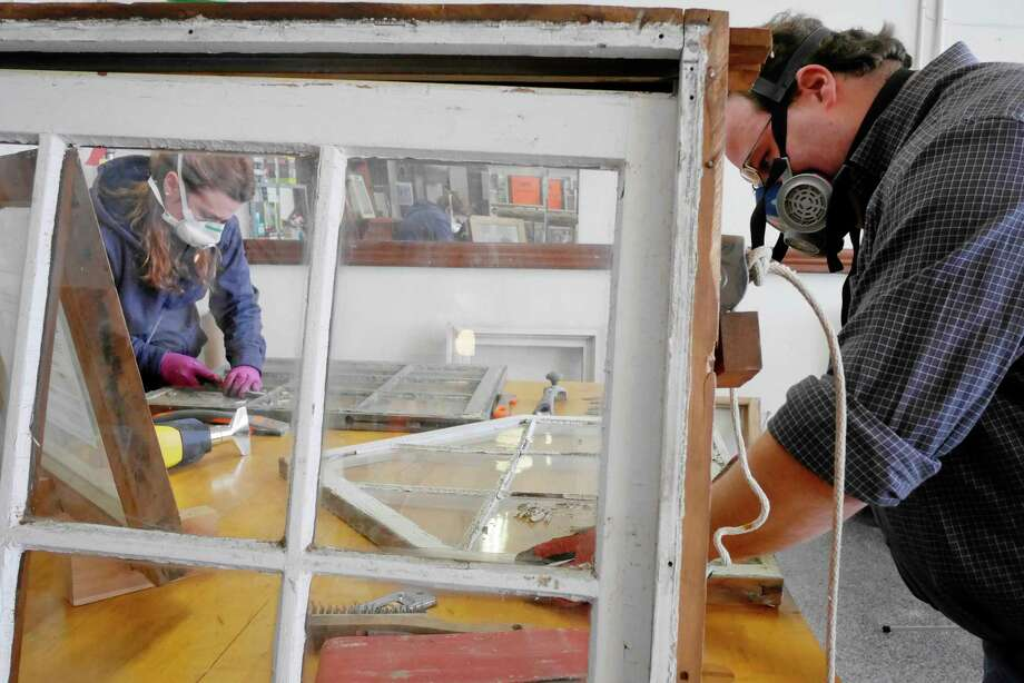 Lisa Crompton, left, a preservation associate with Historic Albany Foundation, and Chris Templin, with Rosch Brothers Contracting, work restoring wood windows at the Historic Albany Foundation's Parts Warehouse on Thursday, March 16, 2017, in Albany, N.Y.  The two will be teaching the Historic Wood Window Restoration class which begins on March 28th and runs for eight weeks.    (Paul Buckowski / Times Union) Photo: PAUL BUCKOWSKI / 20039969A