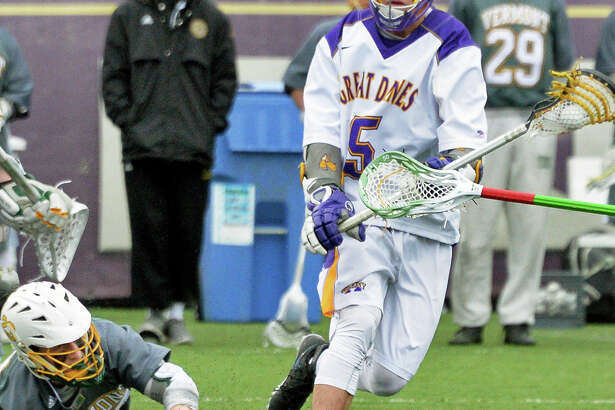 UAlbany's #5 Connor Fields, right, moves in to score during Saturday's American East match against Vermont at John Fallon Field April 9, 2016 in Albany, NY.  (John Carl D'Annibale / Times Union)