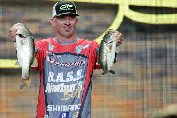 Darrell Ocamica, holding two of his three bass during Friday's weigh-in at Minute Maid Park, totaled 9 pounds, 3 ounces on the first day of competition at the Bassmaster Classic.