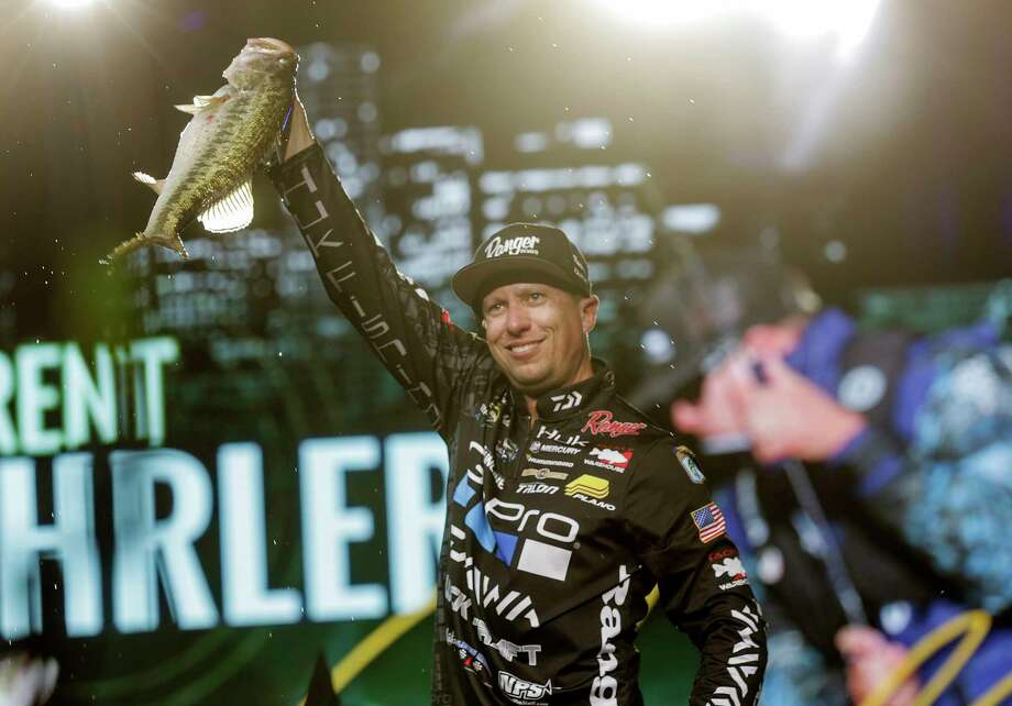Brent Ehrler shows off one of the five largemouths he yanked from Lake Conroe on Saturday to lead the Bassmaster Classic. Photo: Elizabeth Conley, Staff / © 2017 Houston Chronicle