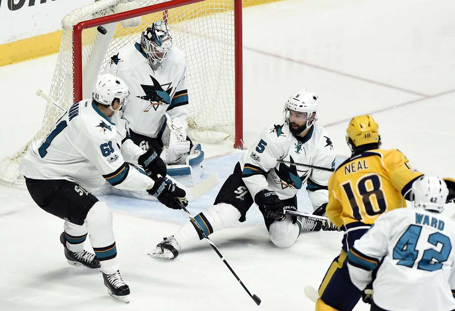 Nashville right wing James Neal scores one of his two goals, beating Sharks goalie Martin Jones (in net) and defensemen Justin Braun (left) and David Schlemko (5) during the second period. Photo: Mark Zaleski, Associated Press