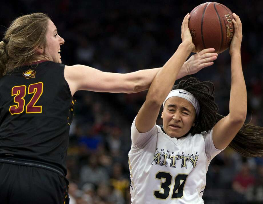 Clovis West's Tess Amundsen (32) knocks the ball out of the hands of Archbishop Mitty's Haley Jones (30) during the fourth quarter of their CIF Girls Open Division high school state championship basketball game, Saturday, March 25, 2017 in Sacramento, Calif. Clovis West won 44-40. Photo: D. Ross Cameron / Special To The Chronicle 2017