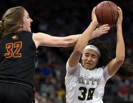 Clovis West�s Tess Amundsen (32) knocks the ball out of the hands of Archbishop Mitty�s Haley Jones (30) during the fourth quarter of their CIF Girls Open Division high school state championship basketball game, Saturday, March 25, 2017 in Sacramento, Calif. Clovis West won 44-40.