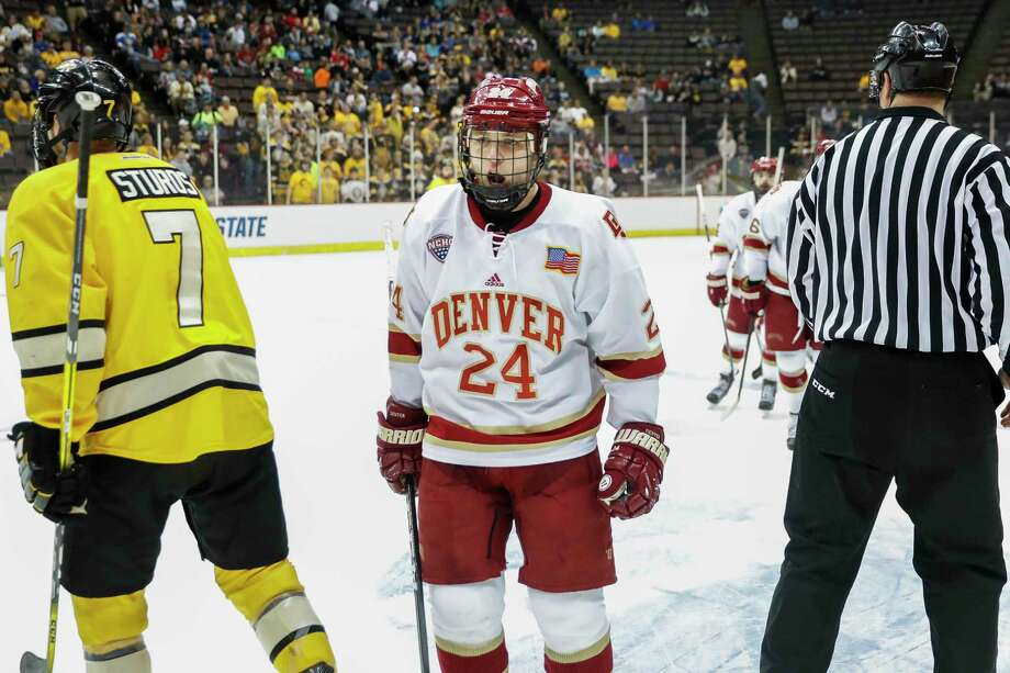 Denver's Colin Staub (24) reacts after scoring during the first period in the regional semifinals of the NCAA college hockey tournament against Michigan Tech, Saturday, March 25, 2017, in Cincinnati. (AP Photo/John Minchillo) ORG XMIT: OHJM101 Photo: John Minchillo / AP