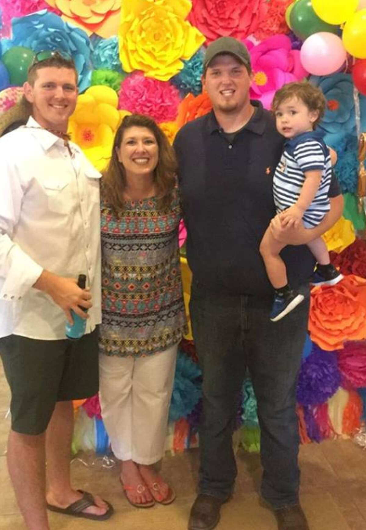 Keri Guillory, seen here with her two sons and her grandson, was struck and killed in Waller County March 25 while biking on a MS150 training ride.
