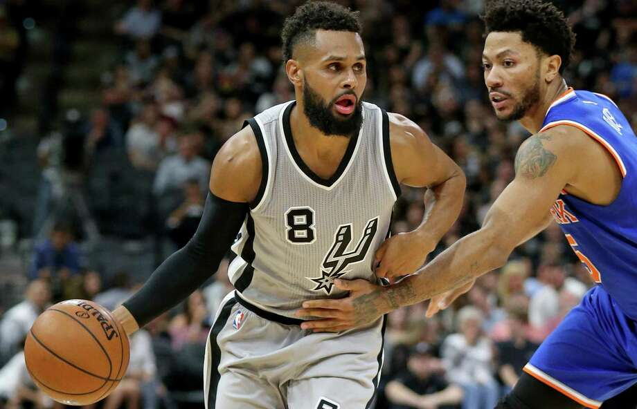 Spurs' Patty Mills drives around the New York Knicks' Derrick Rose during second half action on March 25, 2017 at the AT&T Center. The Spurs won 106-98. Photo: Edward A. Ornelas /San Antonio Express-News / © 2017 San Antonio Express-News