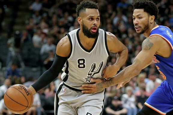 San Antonio Spurs' Patty Mills drives around New York Knicks' Derrick Rose during second half action Saturday March 25, 2017 at the AT&T Center. The Spurs won 106-98.