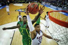 KANSAS CITY, MO - MARCH 25:  Jordan Bell #1 of the Oregon Ducks defends a shot by Landen Lucas #33 of the Kansas Jayhawks in the second half during the 2017 NCAA Men's Basketball Tournament Midwest Regional at Sprint Center on March 25, 2017 in Kansas City, Missouri.  (Photo by Jamie Squire/Getty Images) ORG XMIT: 686517197