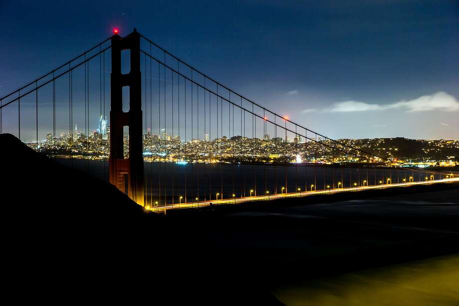In observance of Earth Hour, lights are out on the Golden Gate Bridge in a long exposure. Photo: Santiago Mejia, The Chronicle