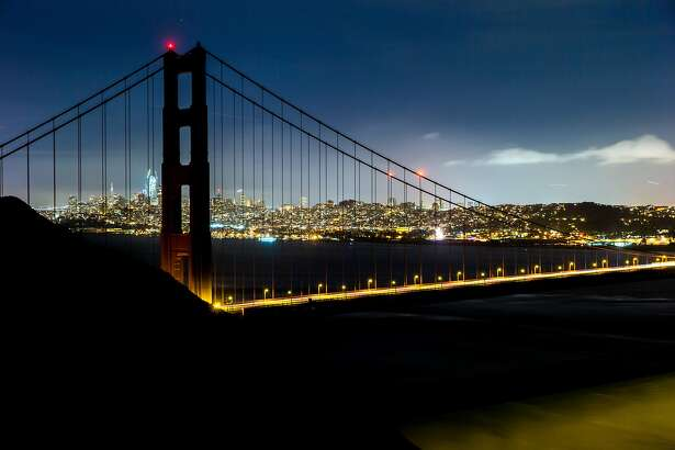 In this long exposure, the Golden Gate Bridge is seen with lights off during Earth Hour on Saturday, March 25, 2017, in the Marin Headlands, Calif. The lights were off from 8:30 p.m. to 9:30 p.m.