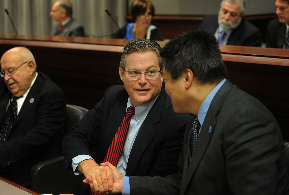 Newly elected state senators Ted Kennedy, Jr., D-12, and Tony Hwang, R-28, shake hands at the start of a public hearing of the Intellectual and Developmental Disability at the Capitol in Hartford on Jan. 15, 2015. Kennedy is son of the late Massachusetts Senator Ted Kennedy, and nephew of President John F. Kennedy.
