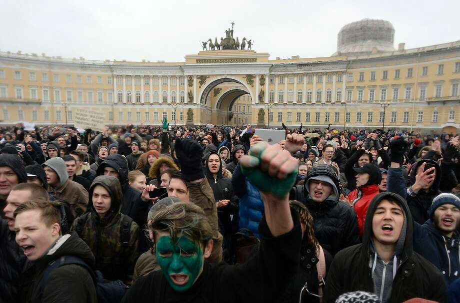 Demonstrators participate in an anticorruption rally in St. Petersburg. The green face paint worn by some participants is a show of solidarity with opposition leader Alexei Navalny. Photo: OLGA MALTSEVA, AFP/Getty Images