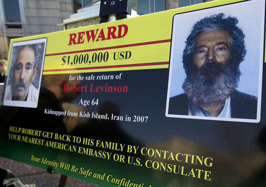 An FBI poster shows images of former agent Robert Levinson, who went missing in Iran in 2007. Photo: Manuel Balce Ceneta, Associated Press