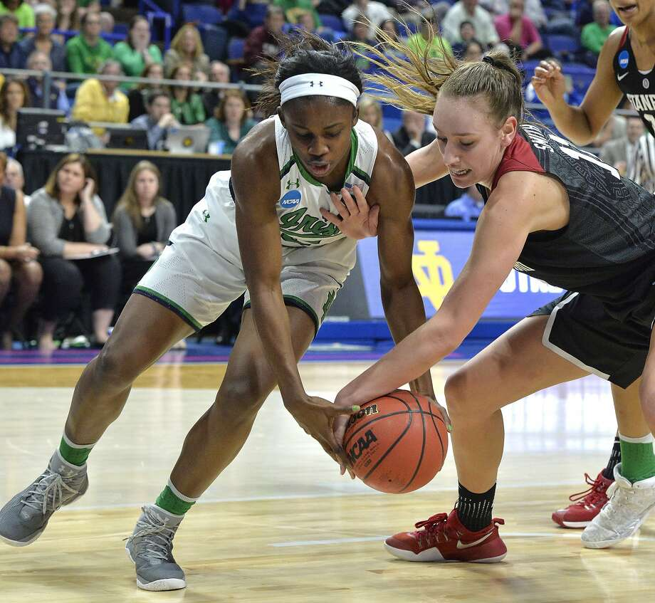 Stanford's Alanna Smith (11) battles Notre Dame's Jackie Young (5) for the ball during the first half of a regional final of the NCAA women's college basketball tournament, Sunday, March. 26, 2017, in Lexington, Ky. (AP Photo/Timothy D. Easley) Photo: Timothy D. Easley, Associated Press