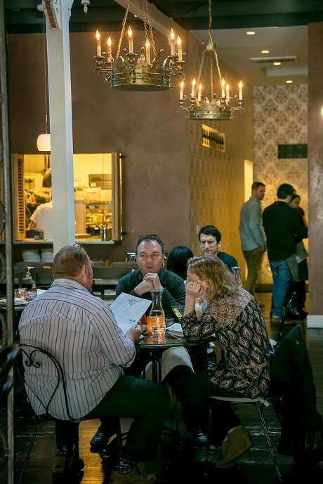 People have dinner at Alba Ray's. Photo: John Storey, Special To The Chronicle
