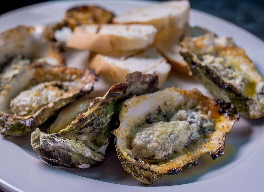 Char-broiled gulf oysters at Alba Ray's. Photo: John Storey, Special To The Chronicle