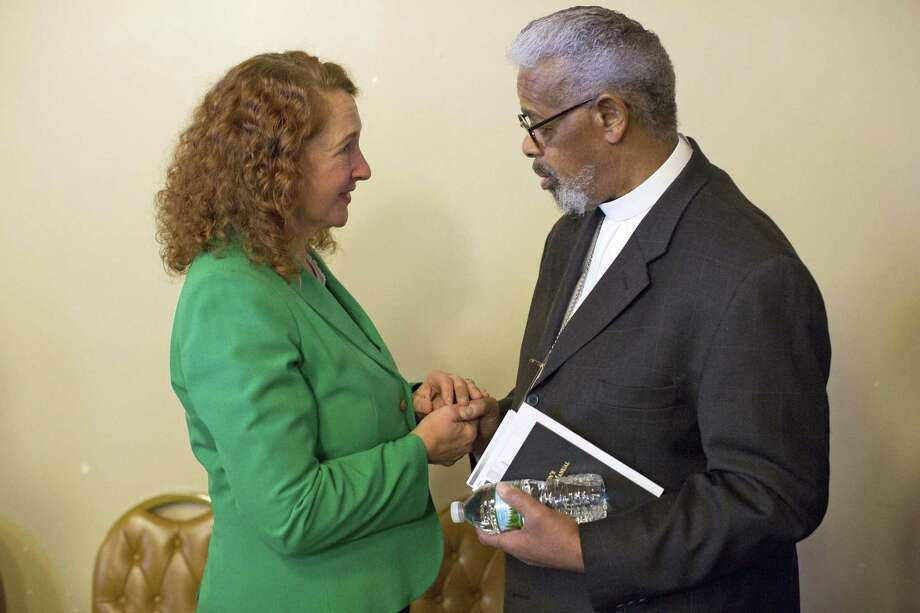 Congresswoman Elizabeth Esty greats the Rev. Preston J. Tallman at the third annual Standing on the Shoulders of Giants Black History Month program at New Hope Baptist Church in Danbury, Conn. on Sunday, March 26, 2017. Photo: Christopher Burns / For Hearst Connecticut Media / The News-Times Freelance