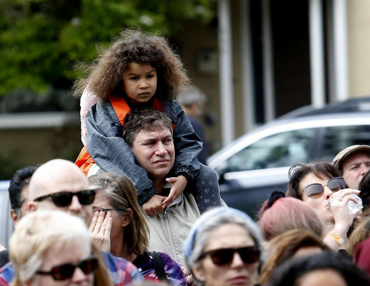 Sydney Weintraub sits on her father, Max Weintraub's shoulders during a gathering in response the cyber bullying, at Albany High School on Sunday, March 26, 2017, in Albany, Calif.on Sunday, March 26, 2017, in Albany, Calif.