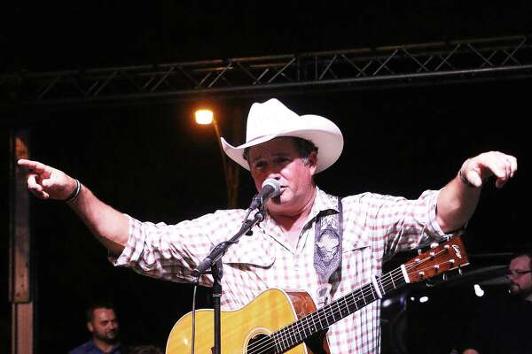 One fan holds up her cell phone to record country artist Tracy Byrd during his concert last Friday night at the Liberty Jubilee. Byrd sang for about an hour before the rain came again.