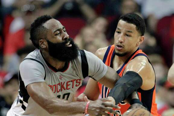 Houston Rockets' James Harden (13) has the ball knocked away by Oklahoma City Thunder's Andre Roberson (21) in an NBA basketball game in Houston, Sunday, March 26, 2017. (AP Photo/Michael Wyke)