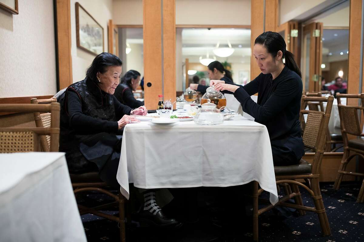 Vera Chan-Waller, right, owner of Yank Sing, pours tea while having lunch with restaurateur Cecilia Chiang in San Francisco, Calif. on Friday, March 24, 2017.