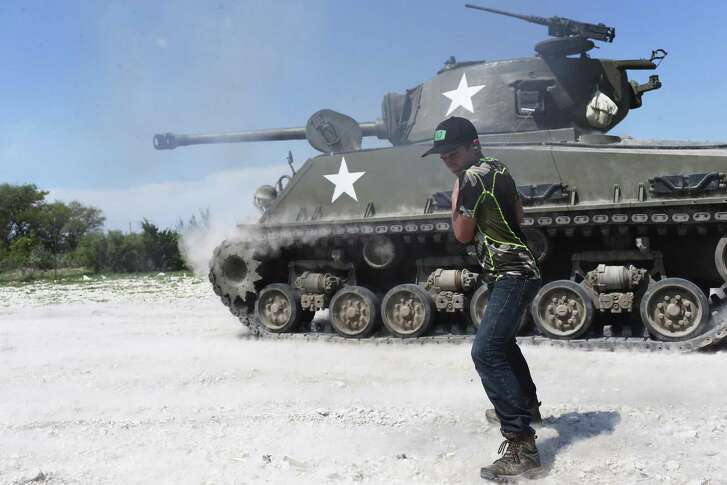 Carson Rogers, 13, shoots a 75mm round from a Sherman tank at Drivetanks.com just north of Uvalde, Texas, Sunday, March 26, 2017. Rogers, of San Antonio, also got to drive the tanks as a birthday present from his father, Darren Rogers.