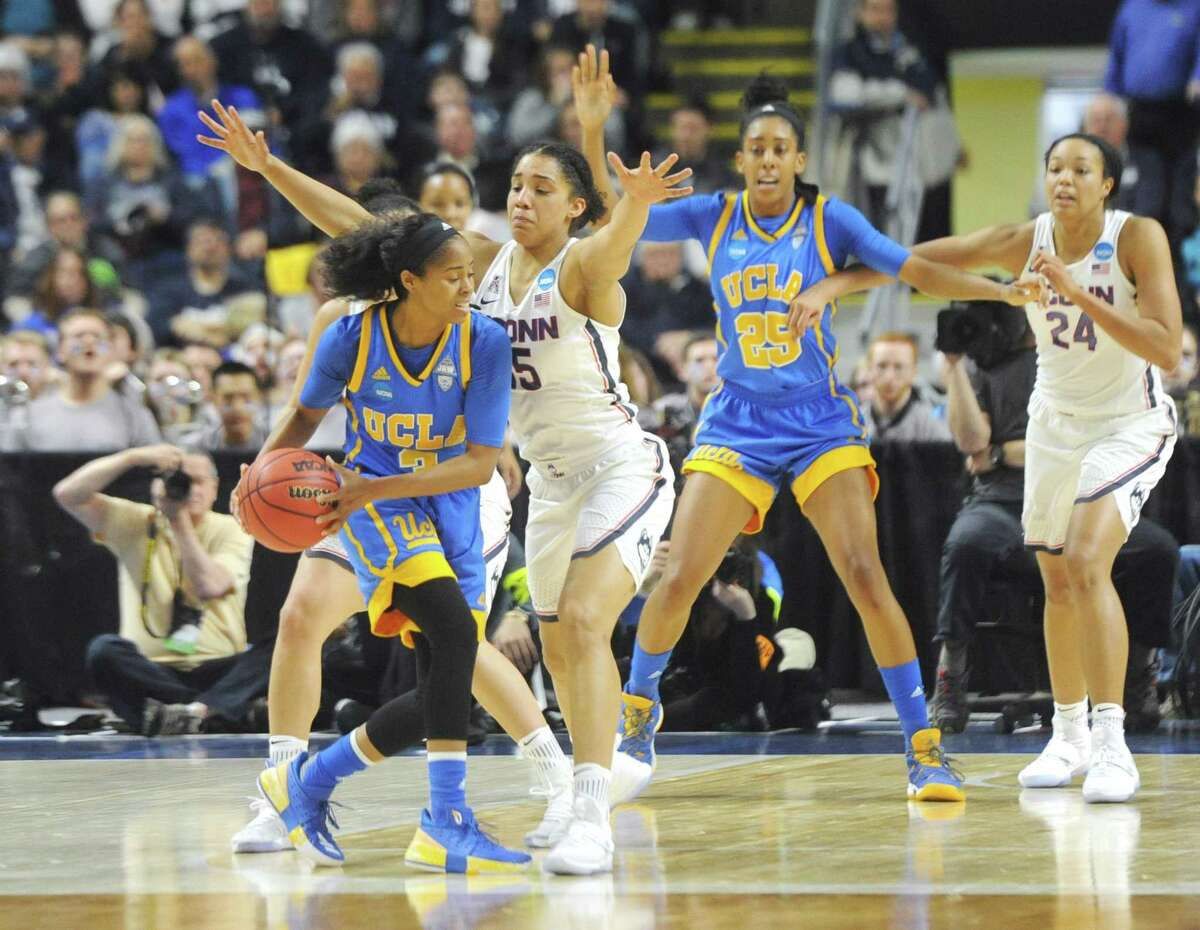 UConn's Gabby Williams (15) plays tight defense on UCLA's Jordin Canada (3) in No. 1 UConn's 86-71 win over No. 4 UCLA in the 2017 NCAA Division I Women's Basketball Championship Regional Semifinal game at Webster Bank Arena in Bridgeport, Conn. Saturday, March 25, 2017.