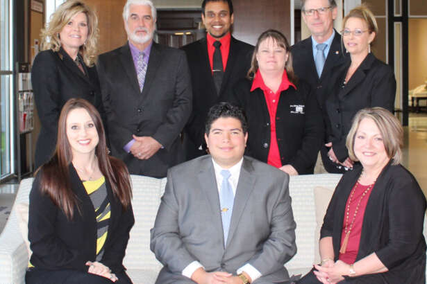 First Liberty National Bank employees front row, l-r, are Chelsey Stringer, Jonathan Galeano, and Janet Meachum. Back row, Jill Anslum, Jerry Ursprung, Prem Dalwadi, Laura Thompson, David Castle and Lisa Hart.