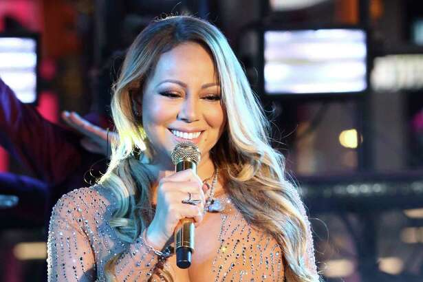 Mariah Carey performs at the New Year's Eve celebration in Times Square on Saturday, Dec. 31, 2016, in New York. (Photo by Greg Allen/Invision/AP) ORG XMIT: NYGA111