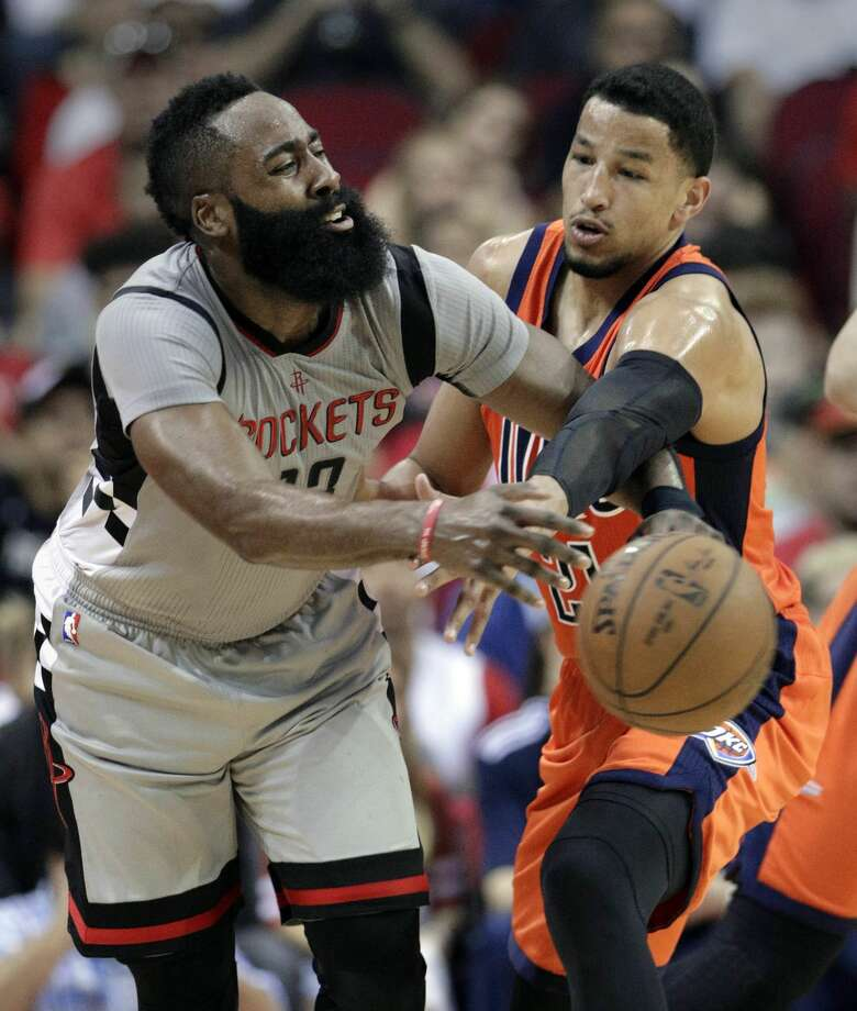 Houston Rockets' James Harden (13) has the ball knocked away by Oklahoma City Thunder's Andre Roberson (21) in an NBA basketball game in Houston, Sunday, March 26, 2017. (AP Photo/Michael Wyke) Photo: Michael Wyke/Associated Press