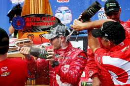 FONTANA, CA - MARCH 26:  Kyle Larson, driver of the #42 Target Chevrolet, celebrates in victory lane after winning the Monster Energy NASCAR Cup Series Auto Club 400 at Auto Club Speedway on March 26, 2017 in Fontana, California.  (Photo by Sarah Crabill/Getty Images)