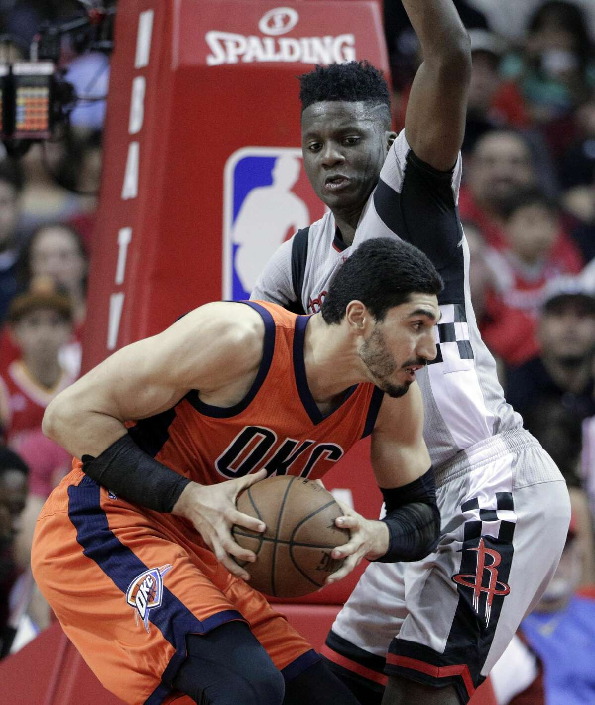Oklahoma City Thunder's Enes Kanter (11) drives to the hoop under pressure from Houston Rockets' Clint Capela (15) in the second half of an NBA basketball game in Houston, Sunday, March 26, 2017. (AP Photo/Michael Wyke)