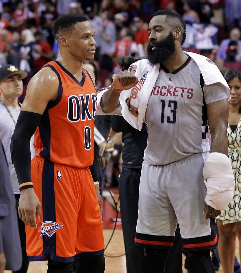 Oklahoma City Thunder's Russell Westbrook (0) and Houston Rockets' James Harden (13) talk on the court after an NBA basketball game in Houston, Sunday, March 26, 2017. (AP Photo/Michael Wyke) Photo: Michael Wyke/Associated Press