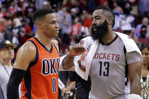 Oklahoma City Thunder's Russell Westbrook (0) and Houston Rockets' James Harden (13) talk on the court after an NBA basketball game in Houston, Sunday, March 26, 2017. (AP Photo/Michael Wyke)