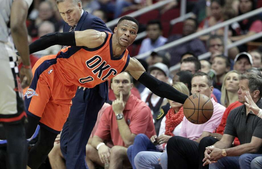 Oklahoma City Thunder's Russell Westbrook (0) dives to keep the ball inbounds against the Houston Rockets in the second half of an NBA basketball game in Houston, Sunday, March 26, 2017. (AP Photo/Michael Wyke) Photo: Michael Wyke/Associated Press