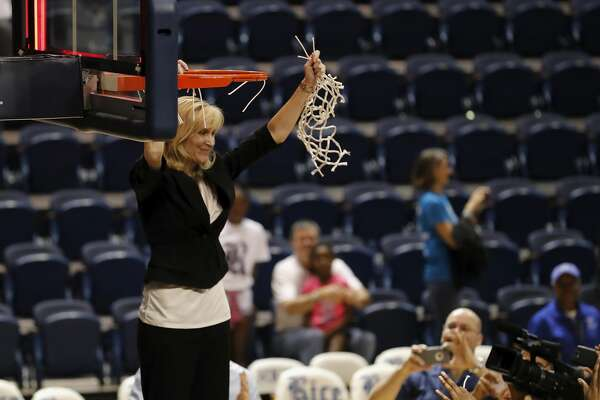 Rice Owls head coach Tina Langley cuts down the net after the Women's Basketball Invitational Championship Game between the UNC-Greensboro Spartans and the Rice Owls at Tudor Field House in Houston, TX on Sunday, March 26, 2017.