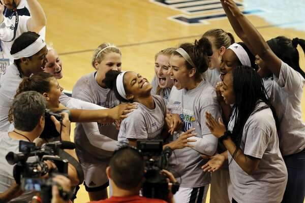 Rice Owls guard Maya Hawkins (3) is swarmed by teammates after being named tournament MVP after the Women's Basketball Invitational Championship Game between the UNC-Greensboro Spartans and the Rice Owls at Tudor Field House in Houston, TX on Sunday, March 26, 2017.