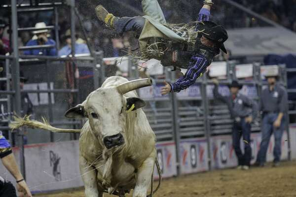 Bull rider Cody Campbell is bucked off of a bull during  the Houston Rodeo on Sunday, March 26, 2017, in Houston. ( Elizabeth Conley / Houston Chronicle )
